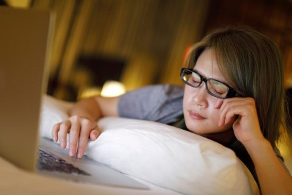 What is Dry Eye - woman rubbing her eyes from eye strain while on the computer